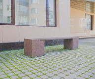 A granite bench in the courtyard of the house Stock Photography