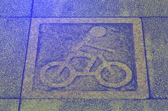 Granite bicycle sign on walk way Stock Photography