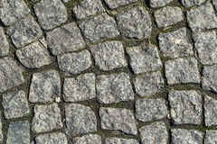 Granite block pavement of the old street Royalty Free Stock Images
