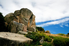 Granite block under blue sky and white cloud Royalty Free Stock Photography