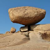 Granite boulder balancing on a edge Royalty Free Stock Photo