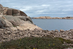 Granite boulders. Stones at the red granite coast on the Swedish west coast royalty free stock photo