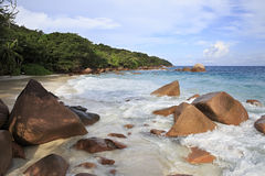 Granite boulders in Indian Ocean on the beach of Royalty Free Stock Photo