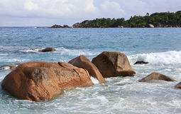 Granite boulders in Indian Ocean on beach of Anse Stock Photography