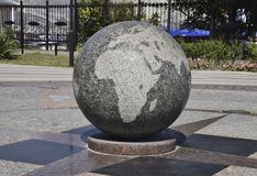 Granite bowl engraved maps of the world. The symbol of peace and Stock Photo