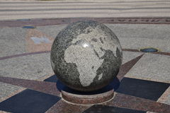 Granite bowl engraved maps of the world. The symbol of peace and unity Royalty Free Stock Images