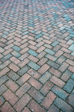 Granite brick road in a perspective view Stock Photos