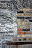 Granite and Bricks. Large granite bricks, mixed with standard clay bricks on an old abandoned industrial building, downtown Minneapolis, MN Stock Image