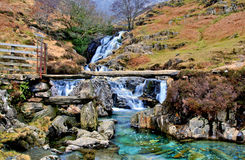 Granite Bridge over Cascading Waterfalls by the Watkins path on the Afon Cwm Llan, Snowdon Stock Image