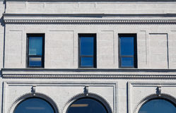 Granite Building with Blue Windows Stock Images