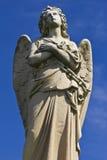 Granite Cemetery Angel. Beautiful Granite Cemetery Angel against a Blue Sky stock image