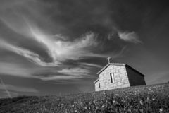 Granite chapel on a hill. Old granite chapel on top of a hill at sunset royalty free stock image