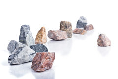 Granite chippings. Granite black and white and brown chippings on a white background royalty free stock photos