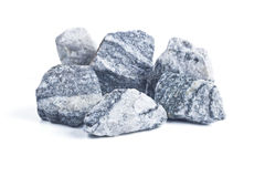 Granite chippings. Granite black and white chippings on a white background stock photography