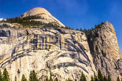 Granite Cliffs With Dome At Top Royalty Free Stock Photography