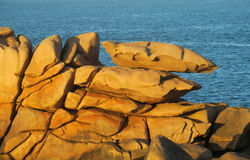 Granite coast rocks at sunset stock photo