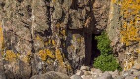 Granite coastal cave near Johns Kapel Royalty Free Stock Images