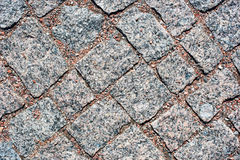 Granite cobbles. With pebbles on top stock images