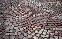 Granite cobblestone road texture. Background texture of granite cobblestone road Royalty Free Stock Images