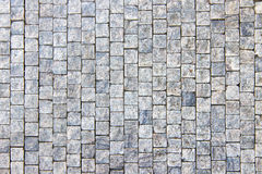 Granite cobblestoned pavement background Royalty Free Stock Image