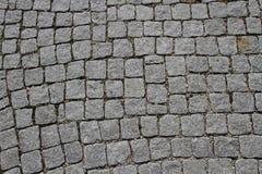 Granite cobblestoned pavement background Stock Image