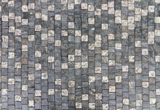 Granite cobblestoned pavement background with regular design