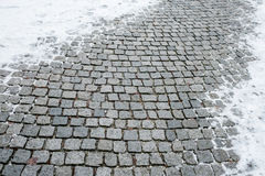 Granite cobblestones in winter Stock Images