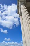 Granite columns. Tall granite columns with a blue sky backdrop Stock Photography