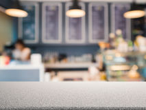 Granite counter top with bakery shop background. Granite counter top with bakery shop blurred background royalty free stock photography