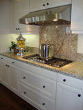 Granite Counters in Kitchen. Beautiful Granite counters and back splash in a designer kitchen Royalty Free Stock Photo