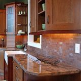 Granite Countertop. A beautiful upscale kitchen with focus on granite countertop and brick back splash stock images