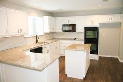 Granite Countertop. Kitchen Granite Countertop with White Cabinets stock photography