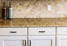 Granite Countertop and Tile Backsplash Royalty Free Stock Images
