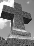 Granite cross headstone. In cemetery shot in black and white royalty free stock images