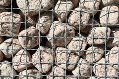 Granite cubes made of natural stone with metal bars Stock Photo