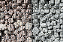 Granite cubes made of natural stone with a metal grid Royalty Free Stock Photography