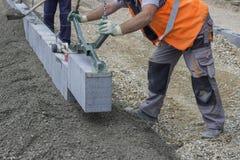 Granite curbing installation, vertical curbing Stock Images