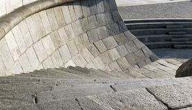 Granite curve stairs with handrail  on a wharf Stock Photo