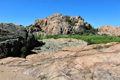 Granite Dells. Exposed bedrock and large boulders of granite, at Granite Dells, that have eroded into an unusual lumpy, rippled appearance Royalty Free Stock Photos