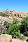 Granite Dells. Exposed bedrock and large boulders of granite, at Granite Dells, that have eroded into an unusual lumpy, rippled appearance Stock Photos