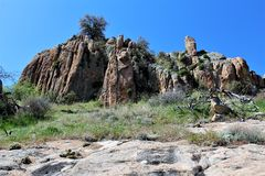 Granite Dells. Exposed bedrock and large boulders of granite, at Granite Dells, that have eroded into an unusual lumpy, rippled appearance Stock Image