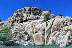 Granite Dells. Exposed bedrock and large boulders of granite, at Granite Dells, that have eroded into an unusual lumpy, rippled appearance Royalty Free Stock Image