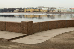 The granite embankment of the city. Royalty Free Stock Image
