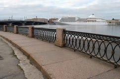 The granite embankment of the Neva river. Royalty Free Stock Image