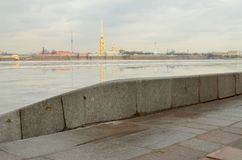 The granite embankment of the Neva. In St. Petersburg the embankment of the Neva river is lined with granite stone.This is a solid and durable material Royalty Free Stock Photos