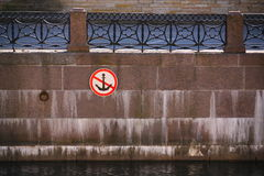 the granite embankment with patterned cast-iron parapet and a sign prohibiting anchor, water Parking ( mooring ). Royalty Free Stock Image