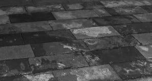 Granite Floor Tiles in Black and white. Purple / Magenta coloured Granite rocks forming the walls and the floor at the badami temple, karnataka stock image