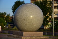Granite globe lit by the setting sun Stock Photo