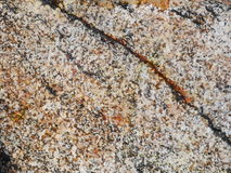 Granite background. The natural color of a granite rock is dependent upon the composition of minerals. Any igneous rock that contains one fifth of quartz is stock photo