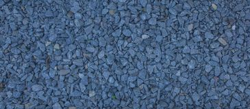 Granite gravel of macadam, Rock blue gray crushed for construction on the ground, Scree texture background Stock Photos